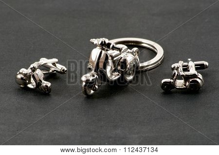 Motorbike Keychain And Cufflinks Over Black