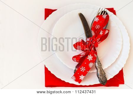 Christmas Plate And Silverware With Red Ribbon