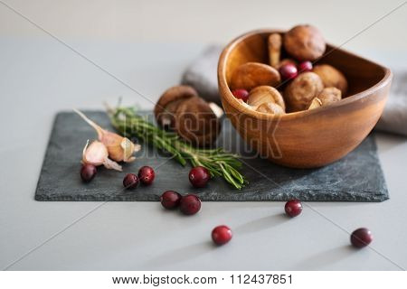 Closeup Of Cranberries On A Kitchen Counter With Mushrooms