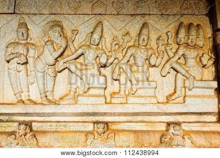 Sculptor work on an ancient Hindu depicting all three most powerful deities Brahma, Vishnu and Shiva