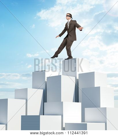 Businessman walking from edge of boxes pile
