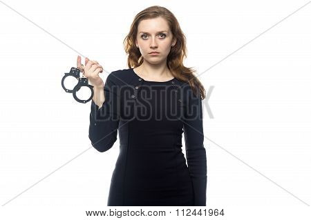 Serious woman with handcuffs