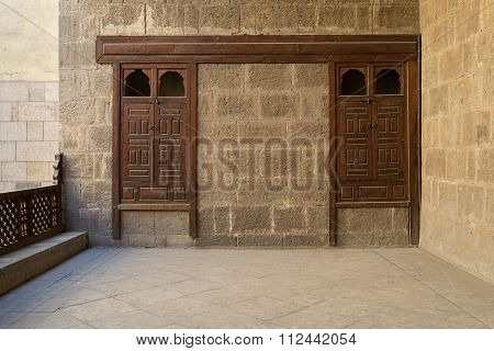 Stone Brick Wall With Two Embedded Ornamented Wooden Cupboards
