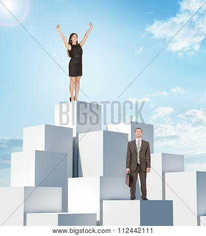 Businesspeople on boxes pile