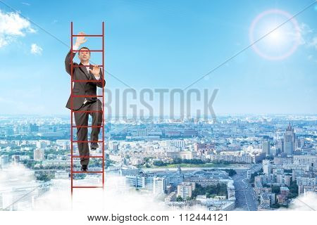 Businessman climbing red  ladder in sky