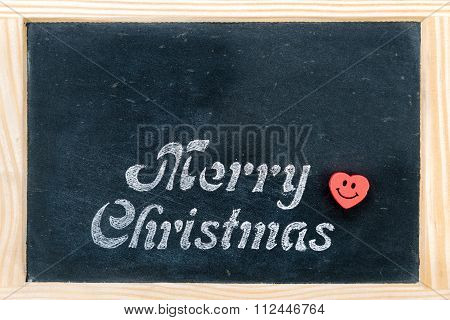 Wooden Frame Vintage Chalkboard With Merry Christmas Message And Red Heart Smiling Emoticon