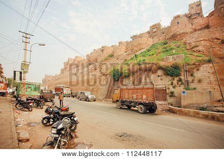 Truck Driving On Dirt Road Near Historical Jaisalmer Fort Built In 1156 Ad
