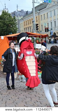 Japanese Tourists Are Photographed With A Figure Of Shrimp In The Cylinder