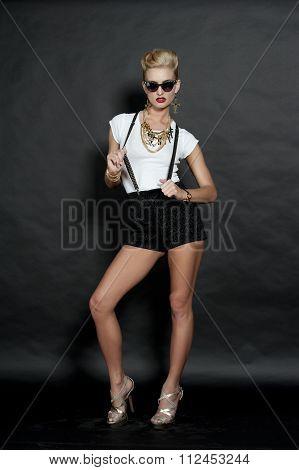 Chic Blonde Fashion Model on Black