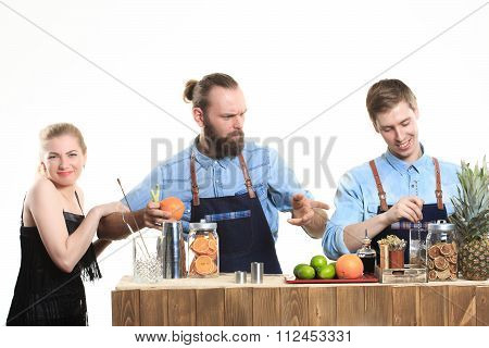 drunk girl clings to the bartenders.