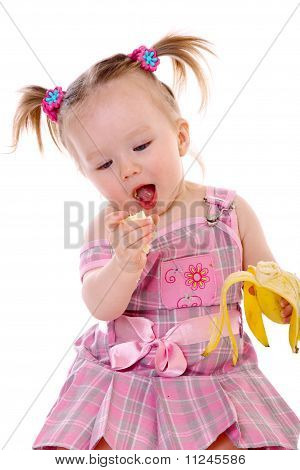 little girl eats banana