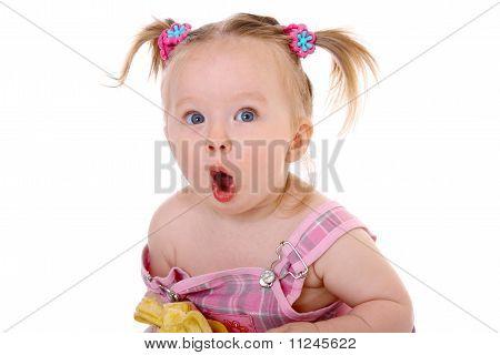 little girl eats banana