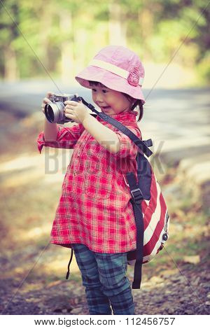 Asian Girl With Digital Camera In Beautiful Outdoor. Retro Style.