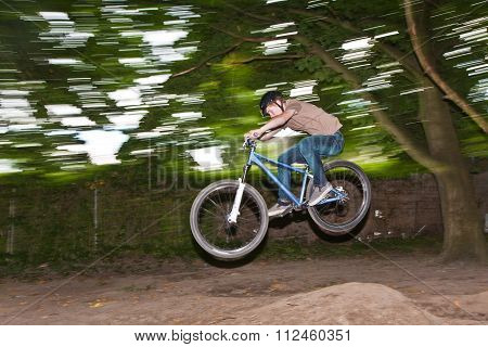 Child Has Fun Jumping With Thé Bike Over A Ramp
