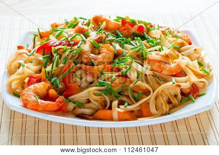 Fettuccini With Shrimp, Vegetables And Spicy Sauce Closeup