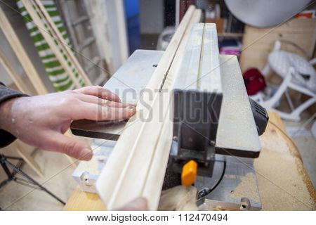Carpenter Using Electric Circular Saw