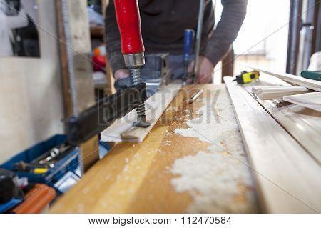 Carpenter Using Electric Plane