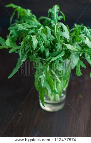 Fresh Ruccola Leaves On The Wooden Background