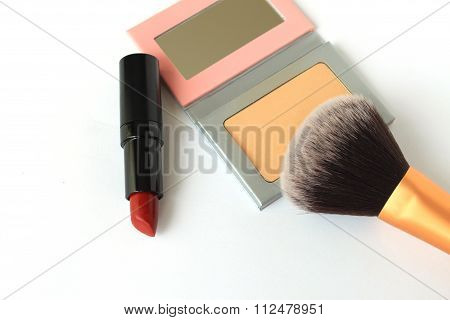 Face powder and red lipstick