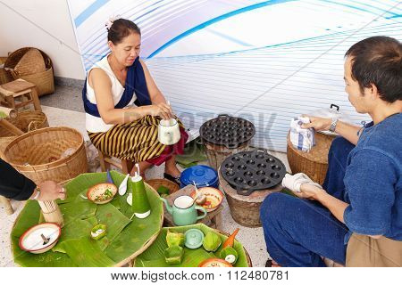 People Making Sweet And Savory Grilled Coconut Rice Hotcake