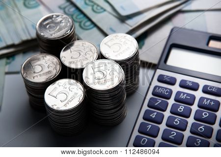 Money In The Form Of Banknotes And Coins With Calculator