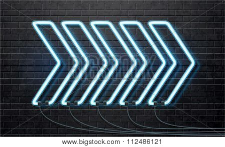 neon blue arrow isolated on black brick wall