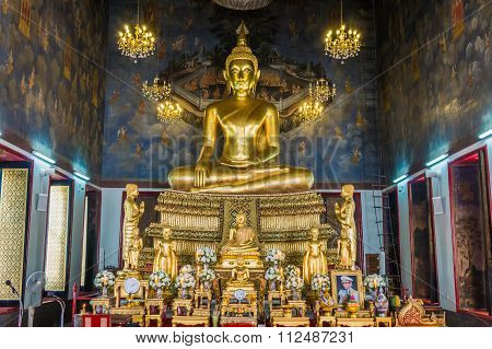 Golden buddha sitting at wat, Bangkok, Thailand