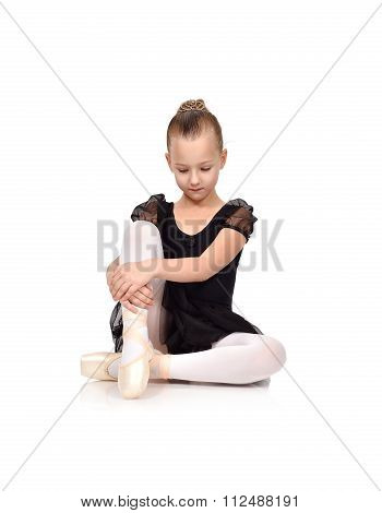 Girl Ballerina Sitting On Floor