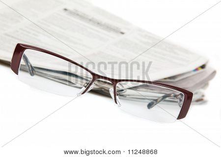 Modern eyeglasses and newspaper