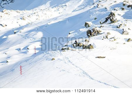 Traces and signposts in the snow at tourist routes