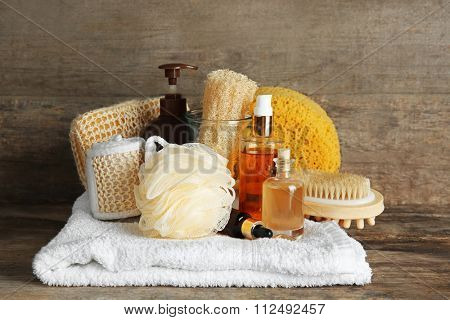 Variety of natural bath tools on wooden background