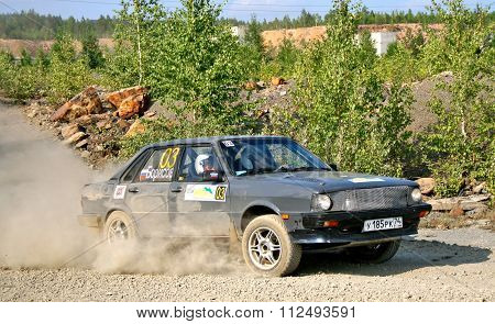 BAKAL, RUSSIA - AUGUST 13: Viktor Borisov's Audi 80 (No. 03) competes at the annual Rally Southern Ural on August 13, 2010 in Bakal, Satka district, Chelyabinsk region, Russia.