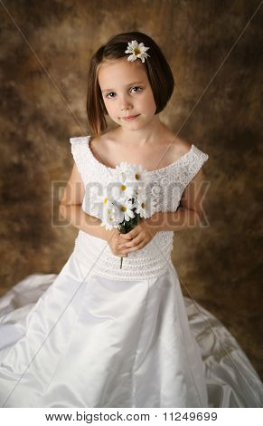 Little Girl Trying On Mommy's Wedding Dress