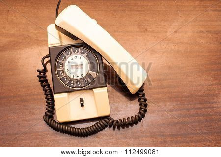 Vintage Rotary Dial Telephone On Old Wooden Table.