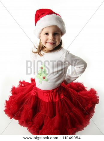 Little Girl Wearing Christmas Santa Hat And Red Pettiskirt