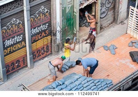 Workers Unloading Truck