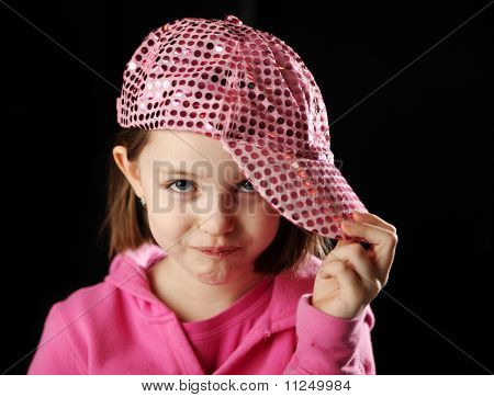 Female Child Wearing Sparkly Pink Baseball Cap