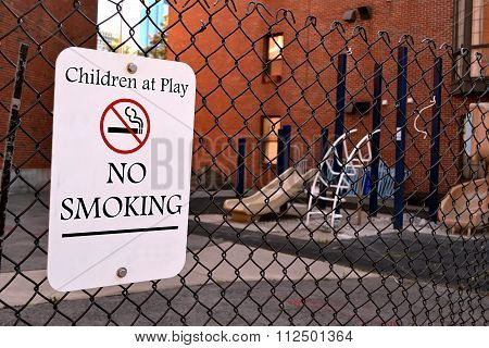 Children At Play - No Smoking As Warning Message, Sign On Metal Grid