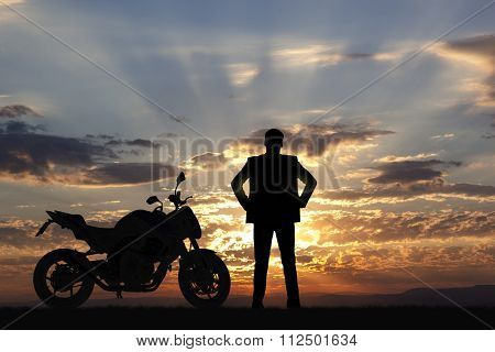 Silhouette sport bike and man at sunset. Motorcycle
