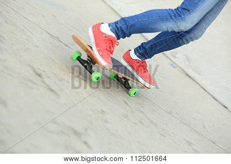 skateboader skateboarding at skatepark