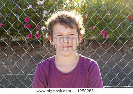 Outdoors Portrait Of Smart Smiling Boy