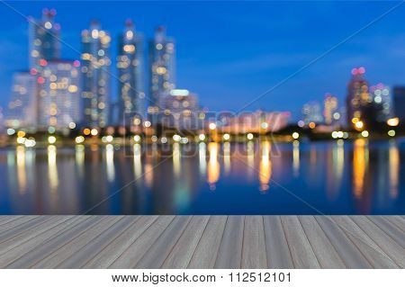 Blurred bokeh lights background city water reflection at night
