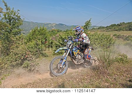 Bikers Riding Enduro Motorcycles Husaberg 390