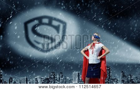 Young woman super hero and dollar sign in spotlight