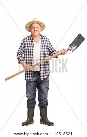 Full length portrait of a mature agricultural worker holding a shovel and looking at the camera isolated on white background