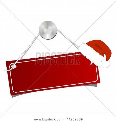 La tableta en un clavo con la Navidad