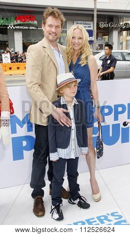 HOLLYWOOD, CALIFORNIA - June 12, 2011. James Tupper and Anne Heche at the Los Angeles premiere of