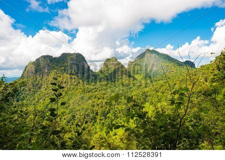 Beautiful Green Mountains Hills And Cloudy Blue Sky