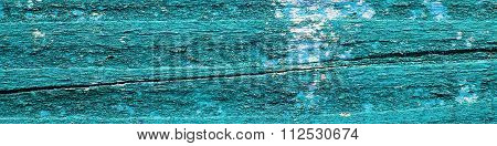 Wooden Background Texture With Flaking Bright Turquoise Green Paint - Panorama.
