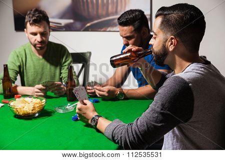 Guys Drinking Beer On Poker Night